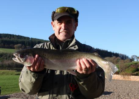 Alan Norman from Stakeford with a 5lb 10oz rainbow caught on a black and green fritz from Coe Crag