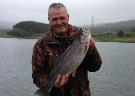 Keith Watson with a cracking 6lb 8oz Rainbow he landed from Long Crag