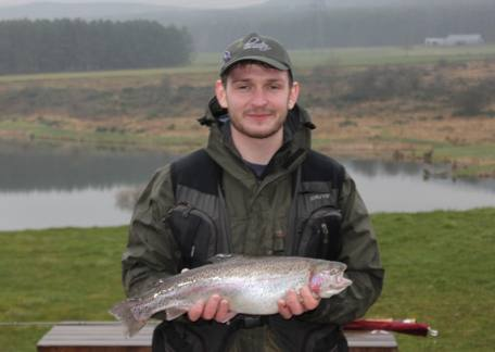 Connor Stoddart from Dipton with a 4lb 9oz trout netted from Coe Crag lake on a PTN