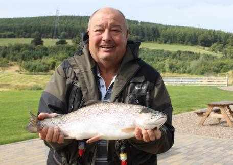 Dennis Stephenson from Crawcrook netted this 5lb rainbow from Long Crag on a black hopper