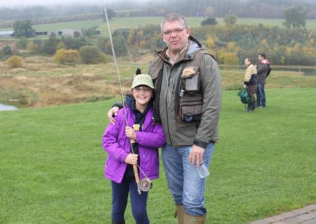 A young Trout Tickler with her Dad before going fishing with the rest of The Morpeth Trout Tcklers