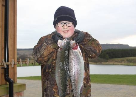 10 year old James Jacobs from West Auckland delighted with 2 fish for 6lb 14oz. Well Done