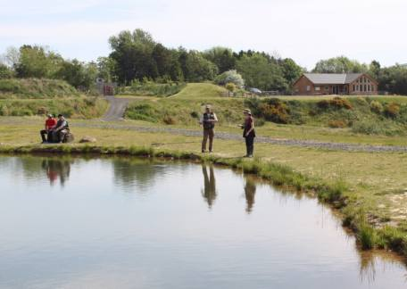 GAIA instructors Barry Mitchell and Richard Philipson with anglers during a casting session