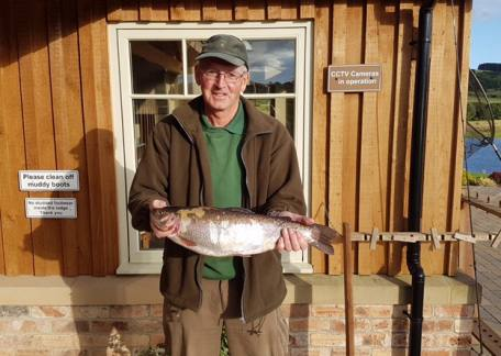 Trevor Wallace with his Best ever trout on a fly, 4lb 13oz netted on a black buzzer