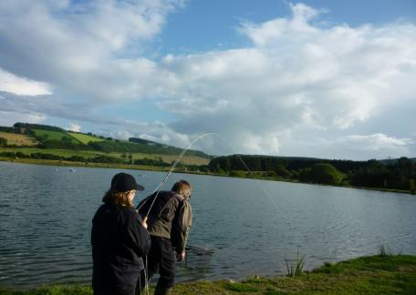 Charlie Cookson into a 6lb rainbow during the competition getting some help from his Dad Dave