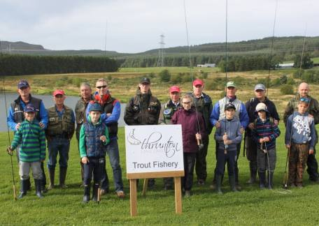 Members of the Trout Ticklers with their parents and helpers after a instruction with Barry Mitchell