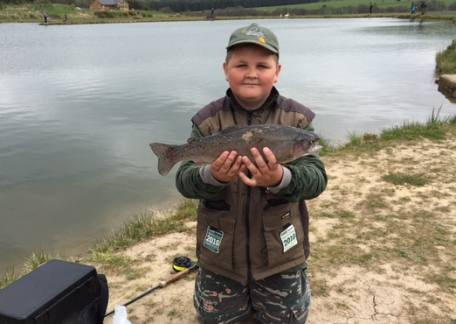 Thrunton Junior Jack Metcalf with his first of 9 fish during a lesson with coach Steve McCann