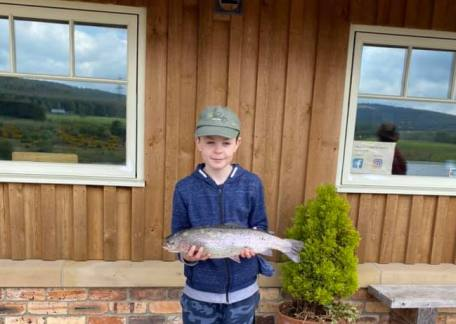 Young Edward Purvis netted this 4lb 6oz Rainbow, while fishing with his Grandma as a Birthday treat