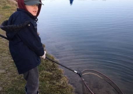 6 year old Edward Graham was delighted to catch, play and net his first trout on a fly. Well done