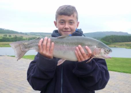 Young Luke Calvin with his first ever trout caught on a fly, a 4lb 11oz rainbow