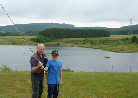 Coach Steve McCann showing a pupil the art of fly casting