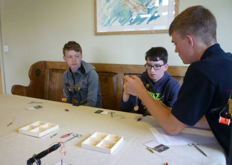 Some of the pupils from Glendale Middle School receiving fly tying advice from Joe