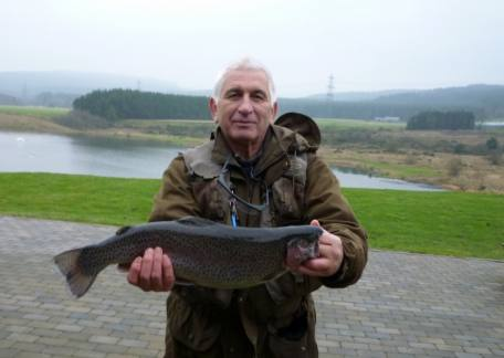 Terry Keenan from Pegswood with a 5lb 8oz rainbow from Long Crag lake on a bloodworm