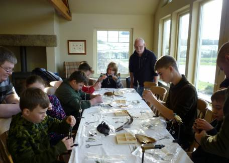 The Thrunton Juniors concentrating during a fly tying session with Paul Griffin