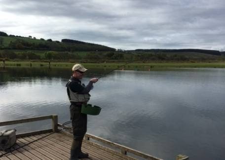 Keith Laidler into his second fish after changing flies to match the hatches on the water