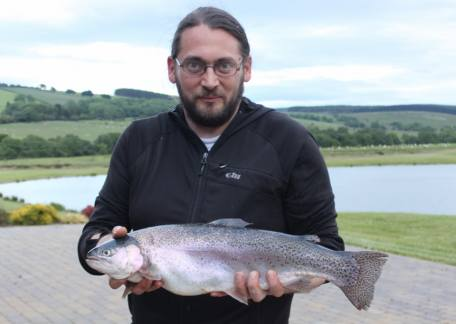 Aiden Charlton from Amble used a black buzzer to land this 4lb 13oz rainbow from Long Crag