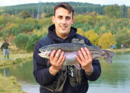 First time visitor Graham Stewart from Hadston with a 5lb 9oz rainbow tempted by a yellow dancer