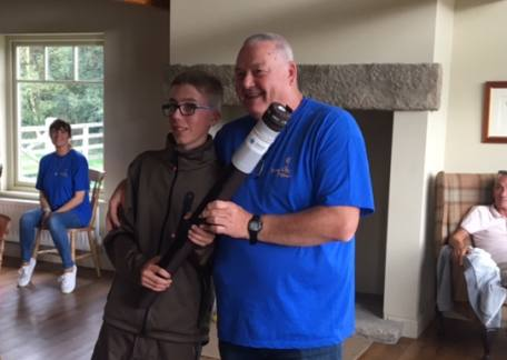 Jamie Potts winner of the Junior Tiny Lives being presented with a rod by Alec Harvey