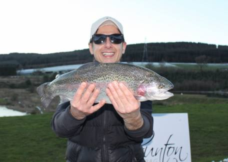 Paul Docherty from FFH fishing for the first time was delighted to net this 4lb 2oz rainbow on a pink puddle bug