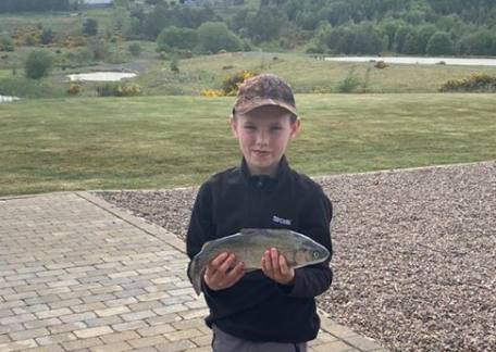 Thrunton junior, Harry Knox with a 2lb Rainbow from Coe Crag