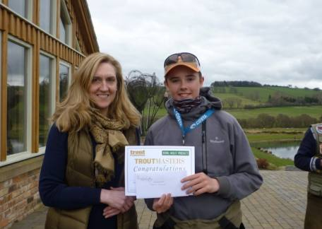 Elliot Guthrie being presented with his winning Troutmasters certificate
