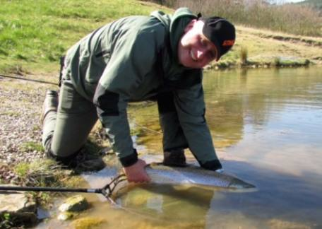 Rob Sharpe, fishing with the Chopwell Chancers releasing a stunning brown back to Long Crag