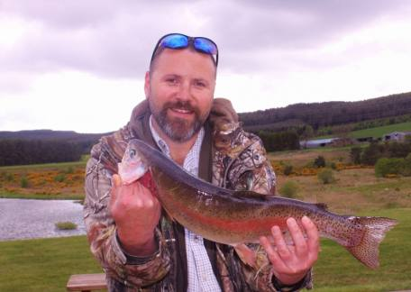 Cameron Graham from Morpeth landed this 4lb rainbow on a black and orange buzzer and spooned it to find black buzzers with orange wings