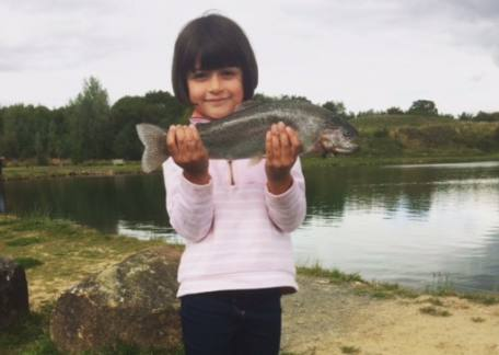 5 year old Alexandra was delighted to land her first trout during a lesson with Lucy Bowden