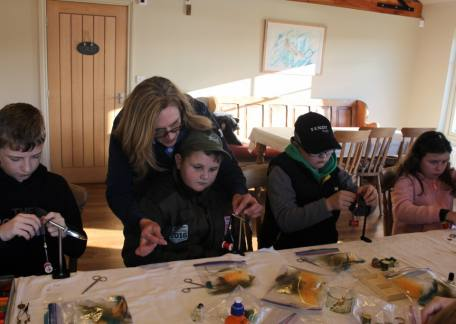Juniors learning to tie an apps bloodworm during a morning session fly tying with Paul Griffin