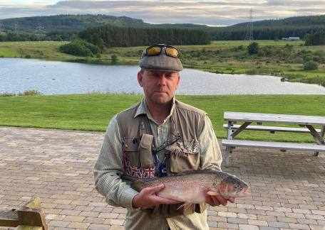 Mark Scott with a 4lb 3oz Rainbow from Long Crag, caught using a Home-tied Emerger