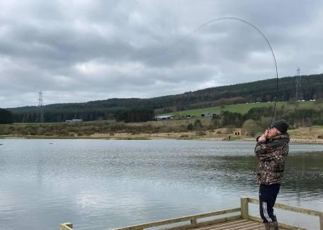 Drennan playing a 4lb Brown on Long Crag Lake