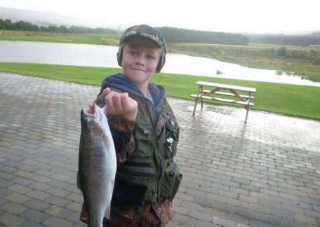 Young Thomas Samples was delighted with his trout after a lesson with Bob Smith ( www.bobsmithflyfishing.co.uk )