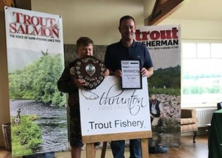 Sam Shepherd the 2019 Junior TroutMasters Chamion, being presented his prize by Anthony Meadows the current senior TroutMasters champion