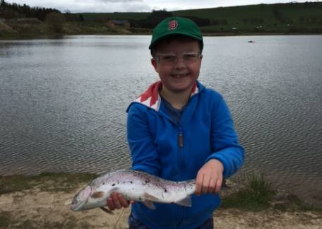 Rory Perkins delighted with a his first fish during a lesson with coach Steve McCann