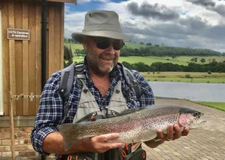Mike Johnson from Sadringham with a 5lb 6oz Rainbow caught on Coe Crag