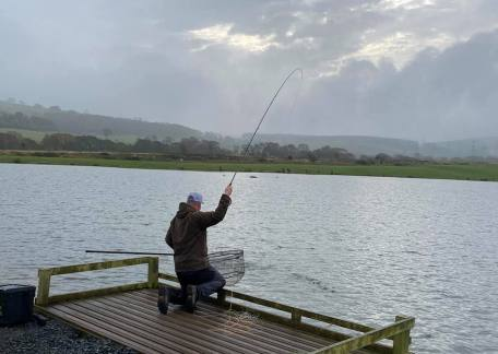 Jamie Scott netting his 6th fish of the day using Olive Apps Bloodworms