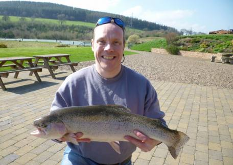 Mathew Lowery was happy to net this 7lb 4oz rainbow from Long Crag on a black buzzer