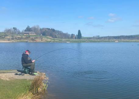 Eric Caisley playing a fish on Scarecrow Point