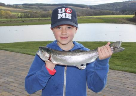 8 year old Harry Armstrong landed his first fish on a black beetle during a lesson with Steve McCann