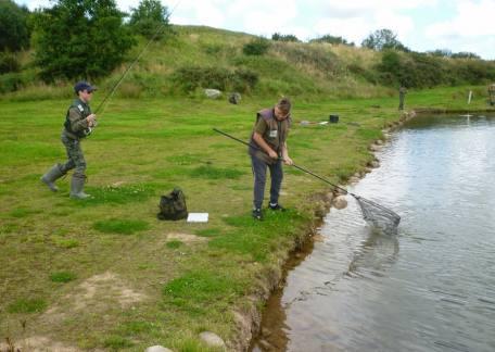 Jack Metcalf helping Joel Ellis land another fish