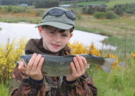 10 yr old Jono Lister was delighted to land this rainbow from Long Crag lake on a foam beetle