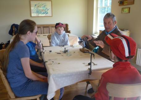 Glendale pupils trying their hand at fly tying with instructor Barry Mitchell