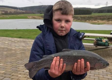 Lewis Longstaff aged 10, landed this cracking 3lb Rainbow from Coe Crag using a Black Lure