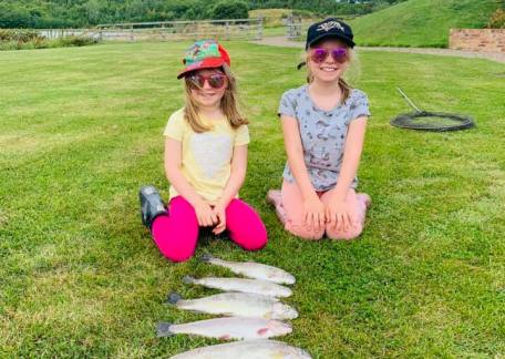Izzy and Olivia with 5 fish caught on Crag End