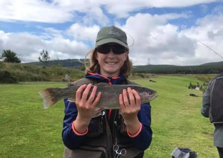 Charlie Cookson with a 2lb 5oz Rainbow caught during The Breast Cancer Now competition