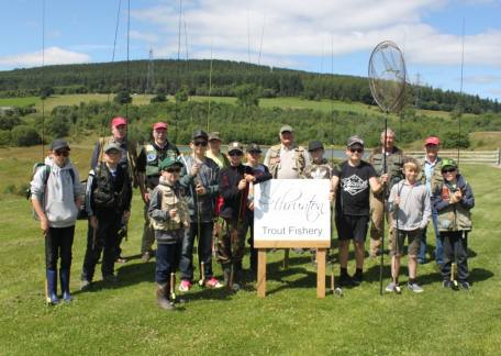 Juniors anglers with their coaches during a session at Thrunton for the Morpeth Chantry Trout Ticklers