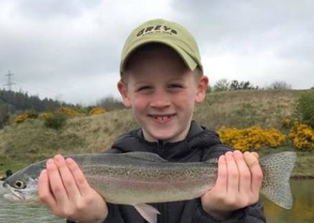 8 year old Austin Tait with his first ever trout on a fly, a shipmans buzzer. Well done Austin