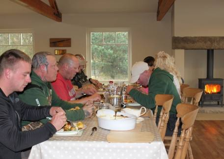 Veterans and helpers from The Fishing for Heroes charity enjoyed their roast lunch in the lodge