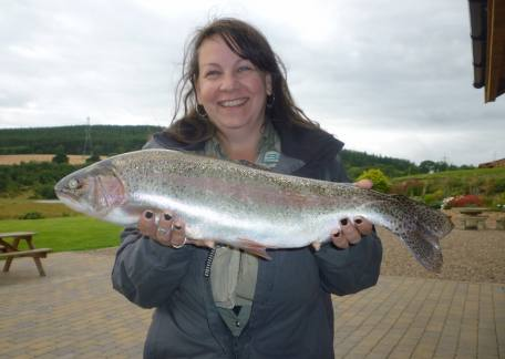 Visiting GAIA instructor Nicole Phillips delighted with Personal Best trout, a 4lb 13oz rainbow landed on a back buzzer