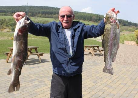 On his second visit Alan Robinson netted these 2 rainbows of 5lb 5oz and 5lb on a gold humungus
